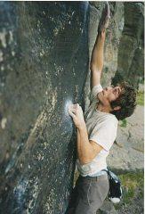 Neil K slaps at Almscliff, Yorkshire