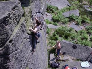 Andy on The Sole (HVS 5b) at Crookrise, Jay belaying, Veritys' right foot at right edge