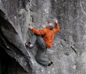 thekettle getting comfortable on 'I can, I can't' V5, Carrock Fell Boulders.