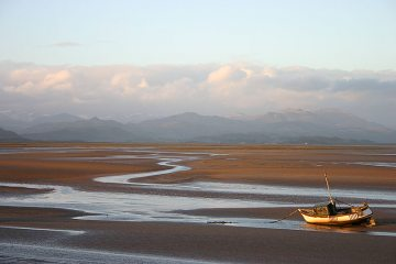 Sun setting over Duddon Estuary with Scafell and The Old Man of Coniston in the background