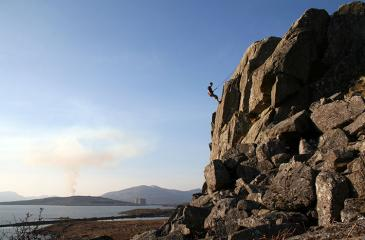 Ralph at the top of First Flight (VS 4c). Photo by Mark Clague.