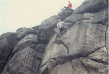 Duncan Drake soloing Wall of Horrors, E3 6a  Wayne Pearson hurling good-natured abuse from the top of the crag.
