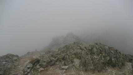 Looking down Swirral Edge in the mist.