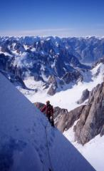Colwyn Jones on the first ascent of the South-West Ridge of Dansketinde (TD+, 2930m), Staunings Alps, East Greenland.