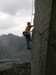 Sion Idwal Long seconding XXXposure (6a+)in the Llanberis slate quarries